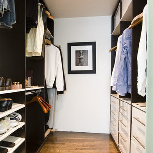 Example of a mid-sized trendy men's dark wood floor walk-in closet design in Miami with white cabinets and flat-panel cabinets