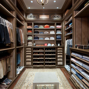 This is an example of a large traditional men's walk-in wardrobe in Miami with open cabinets, dark wood cabinets and dark hardwood floors.