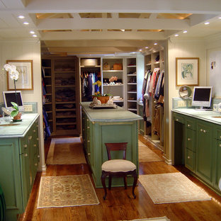 Large traditional gender-neutral walk-in wardrobe in San Diego with raised-panel cabinets, distressed cabinets and medium hardwood floors.