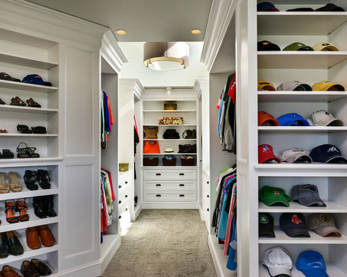 Example Of A Large Coastal Gender Neutral Carpeted Walk In Closet Design In  Boston