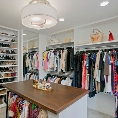 Large elegant women's carpeted walk-in closet photo in Baltimore with white cabinets and open cabinets
