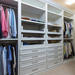 Inspiration for a large transitional gender-neutral carpeted walk-in closet remodel in Miami with flat-panel cabinets and white cabinets
