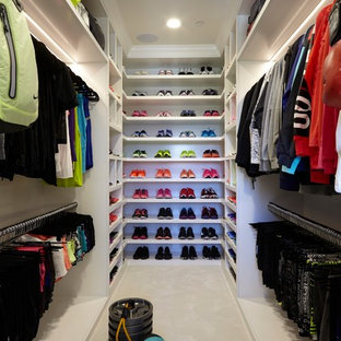 Trendy women's carpeted and white floor walk-in closet photo in Los Angeles with open cabinets and white cabinets