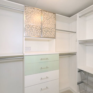 Mid-sized trendy light wood floor and brown floor walk-in closet photo in Orange County with flat-panel cabinets and green cabinets