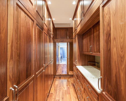 Inspiration For A Large Timeless Gender Neutral Medium Tone Wood Floor  Walk In Closet