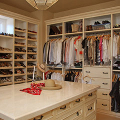 mediterranean closet by Landmark Builders