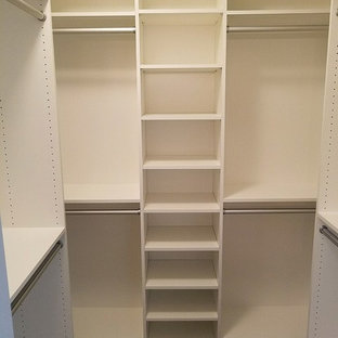 Inspiration for a small arts and crafts walk-in wardrobe in Other with flat-panel cabinets, white cabinets, carpet and brown floor.