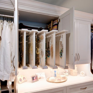 Large elegant gender-neutral walk-in closet photo in Other with white cabinets and recessed-panel cabinets