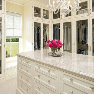 Elegant walk-in closet photo in Dallas with white cabinets
