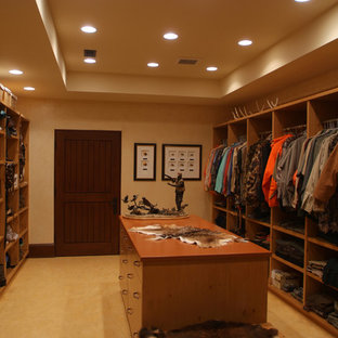 Expansive traditional men's walk-in wardrobe in Grand Rapids with ceramic floors.