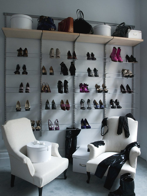 ... women's dressing room photo in New York with open cabinets and carpet