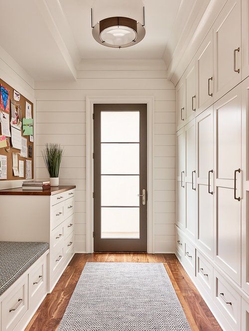 Transitional Gender Neutral Medium Tone Wood Floor Walk In Closet Photo In  Charlotte With