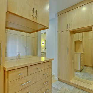 Photo of a large midcentury gender-neutral dressing room in San Francisco with flat-panel cabinets, light wood cabinets, slate floors and beige floor.