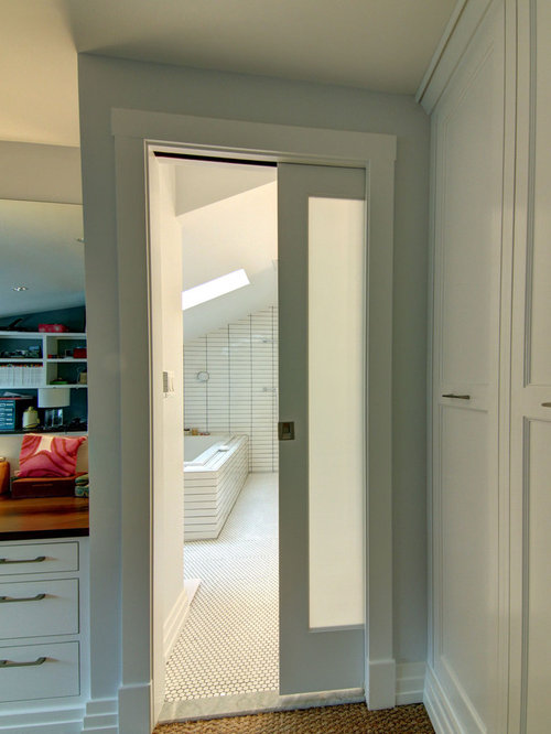 eclectic black pocket door storage and wardrobe design ideas