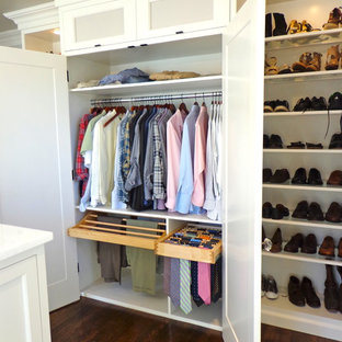Large trendy gender-neutral dark wood floor walk-in closet photo in Newark with open cabinets and white cabinets
