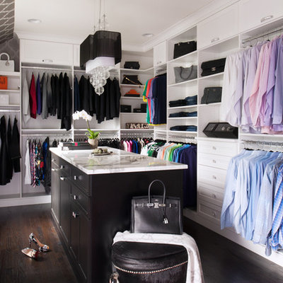 Dressing room - transitional gender-neutral dark wood floor dressing room idea in Philadelphia with open cabinets and white cabinets