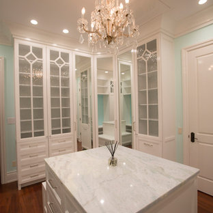 Inspiration for a large timeless women's medium tone wood floor and brown floor walk-in closet remodel in Tampa with shaker cabinets and white cabinets