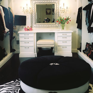Dressing room - large transitional women's dark wood floor dressing room idea in New York with flat-panel cabinets
