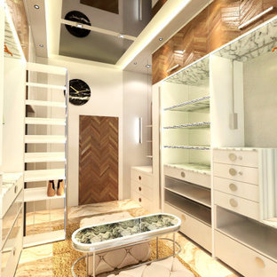 Ispirazione per una cabina armadio unisex design di medie dimensioni con ante lisce, ante bianche, pavimento in marmo, pavimento beige e soffitto in perlinato