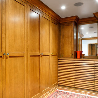 Inspiration for a large traditional men's walk-in wardrobe in Los Angeles with shaker cabinets, medium wood cabinets and medium hardwood floors.