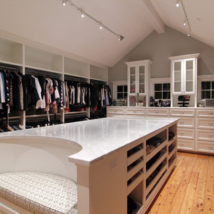 Example of a classic walk-in closet design in Houston with white cabinets