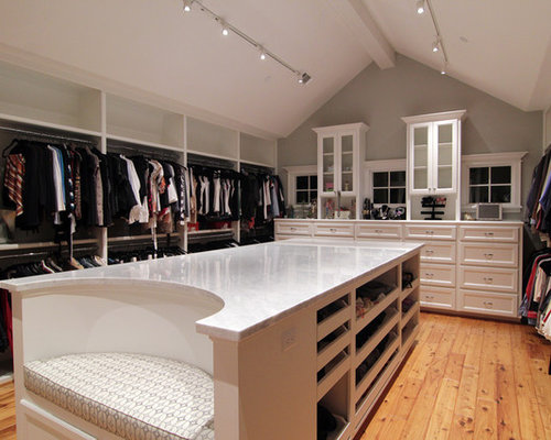 Example Of A Classic Walk In Closet Design In Houston With White Cabinets