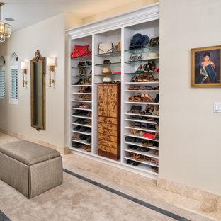 Walk-in closet - large mediterranean women's porcelain tile and beige floor walk-in closet idea in Other
