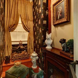 Example of a classic medium tone wood floor closet design in New York