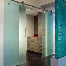 Contemporary Closet by Logue Studio Design Inc.