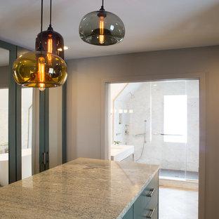 Immagine di un grande spazio per vestirsi unisex moderno con ante in stile shaker, pavimento in legno massello medio, pavimento marrone e ante blu