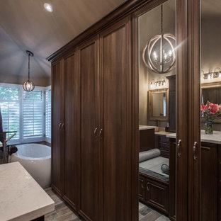 Idee per una grande cabina armadio classica con ante con riquadro incassato, ante in legno scuro, pavimento in pietra calcarea e pavimento grigio