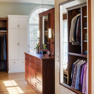 Large transitional medium tone wood floor dressing room photo in Boston with flat-panel cabinets and dark wood cabinets