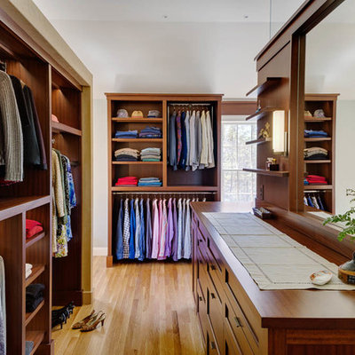 Inspiration for a large timeless gender-neutral light wood floor dressing room remodel in Boston with shaker cabinets and medium tone wood cabinets