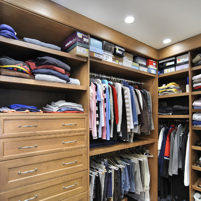 Example of a classic gender-neutral closet design in Miami with open cabinets and medium tone wood cabinets