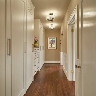 Inspiration for a mid-sized timeless gender-neutral dark wood floor and brown floor walk-in closet remodel in Dallas with shaker cabinets and white cabinets