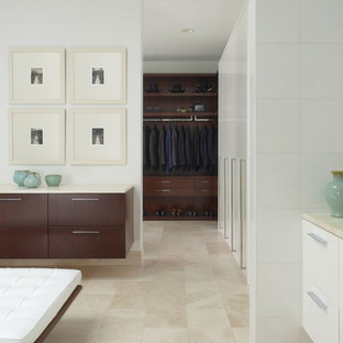 Design ideas for a contemporary dressing room in Detroit with dark wood cabinets and travertine flooring.