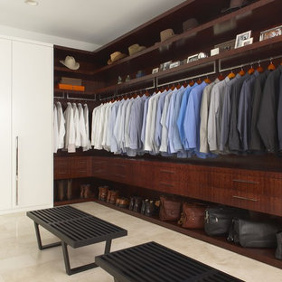 Inspiration for a contemporary men's walk-in closet remodel in Detroit with dark wood cabinets