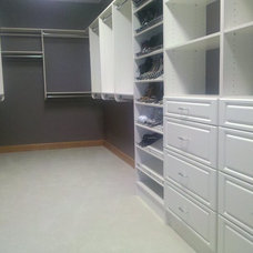 Contemporary Closet by Distinctive Closets
