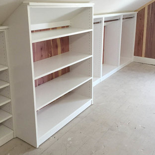 Inspiration for a large transitional gender-neutral carpeted walk-in closet remodel in Cincinnati with flat-panel cabinets and white cabinets