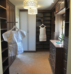 contemporary closet Master Closet in Roman Walnut Italian Lago finish