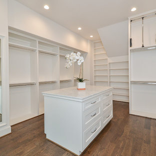Inspiration for a mid-sized traditional gender-neutral walk-in wardrobe in Houston with open cabinets, white cabinets, medium hardwood floors and brown floor.