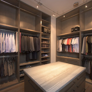 Example Of A Large Minimalist Men S Painted Wood Floor Walk In Closet Design Houston