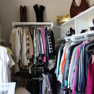 Small transitional gender-neutral walk-in closet photo in Raleigh with open cabinets and white cabinets