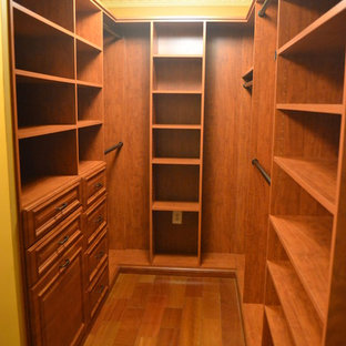 Design ideas for a mid-sized transitional men's walk-in wardrobe in DC Metro with medium wood cabinets and medium hardwood floors.
