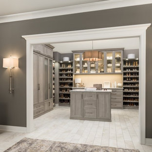 Walk-in closet - huge modern gender-neutral beige floor walk-in closet idea in Chicago with shaker cabinets and gray cabinets
