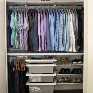 Mid-sized midcentury men's built-in wardrobe in Miami with medium hardwood floors.