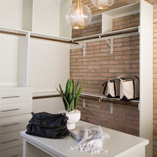 Large mid-century modern gender-neutral carpeted dressing room photo in Other with flat-panel cabinets and white cabinets