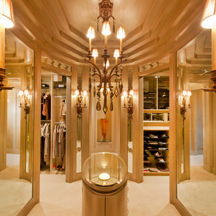 Expansive transitional women's dressing room in Omaha with flat-panel cabinets, brown cabinets and carpet.