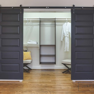 Inspiration for a mid-sized transitional women's walk-in wardrobe in Raleigh with dark hardwood floors.