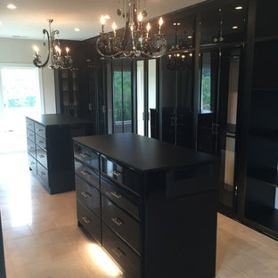 Inspiration for a large modern women's walk-in wardrobe in Nashville with flat-panel cabinets, black cabinets and porcelain floors.